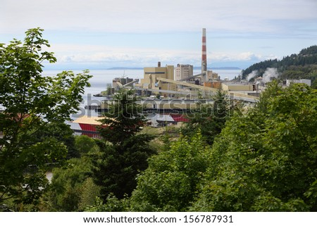 Powell River Mill, British Columbia. A pulp mill on the shore of Georgia Strait. Powell River, British Columbia, Canada. - stock photo