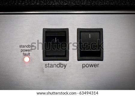 power and standby button of a sound studio equipment