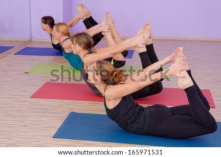 Power Ashtanga Yoga class is in session   - stock photo
