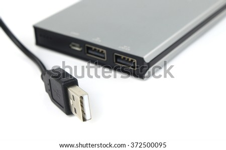 Power Bank Charger and USB Cable On White Background: selective focus