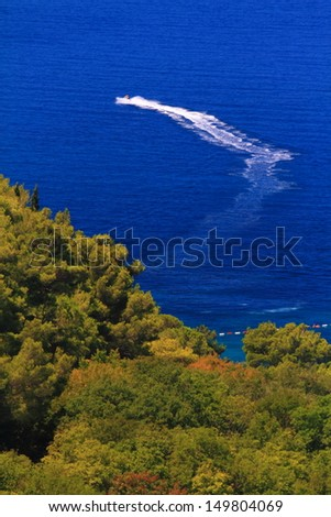 Power boat on the blue Adriatic sea, Montenegro - stock photo