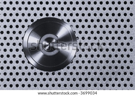 Power Button on Metal Hole Background. - stock photo
