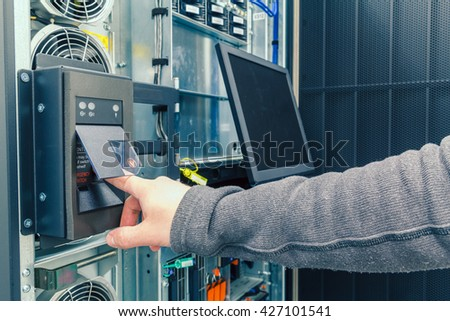 power button on the enterprise server and the hand engineer - stock photo
