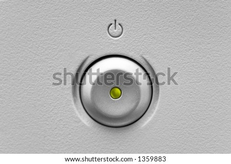 Power button with a green light - stock photo