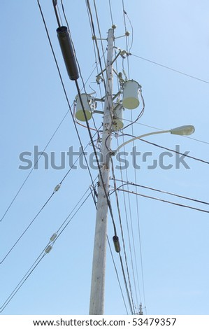 power cable and electric hydro lines outdoors blue sky background - stock photo