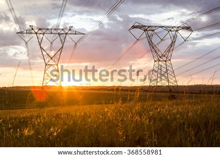 Power Cables High Voltage two with sunset - stock photo