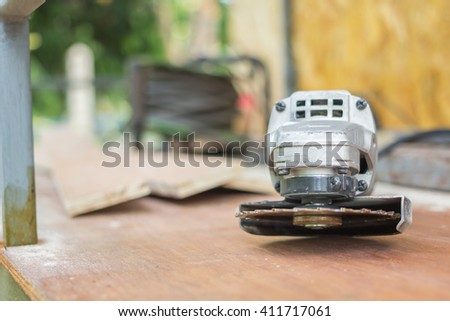 power circle saw,stacked wood harvesting in joinery - stock photo