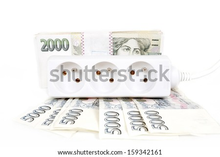 power cord and banknotes of czech crowns money concept of expensive energy bill - stock photo