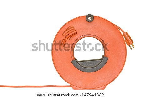 Power cord extension,3 prong plug rolled up on orange plastic spool,black handle,knob.Electric cable for home or office to supply power.Plug hangs down from top of reel.Isolated on a white background. - stock photo