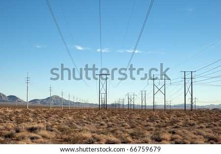 Power distribution lines in the desert - stock photo