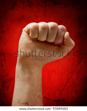 power fist on grunge background - stock photo