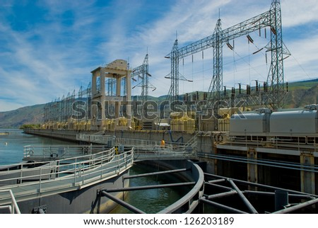 power generating equipment at a large hydro electric dam on a river - stock photo