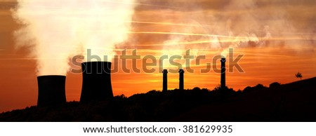 Power generating factories in the mountains at sunset backlight - stock photo