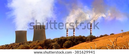 Power generating factories in the mountains. Concept of environmental pollution. Panoramic horizontal composition - stock photo