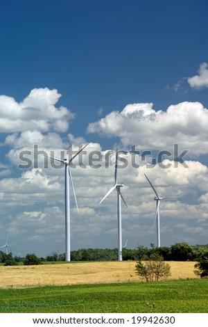 Power Generating Windmills on green field. Alternative energy source. Ontario, Canada - stock photo