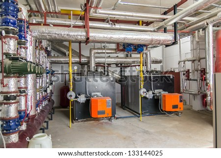 Power Generators In A Factory Machinery Room - stock photo