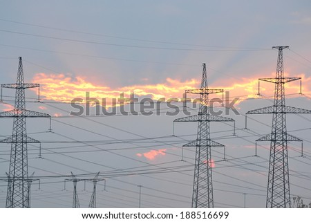 Power line at sunset, outskirts of St. Petersburg, Russia. - stock photo