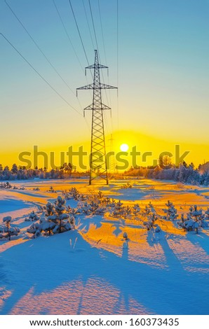 Power line frosty winter evening - stock photo