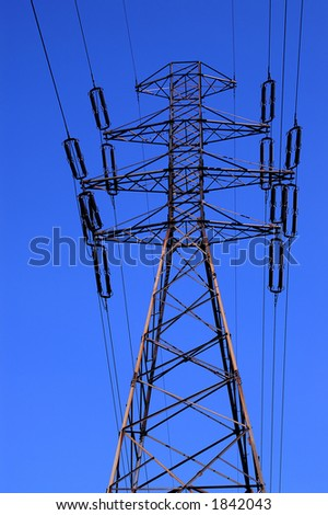 Power line, high voltage tower on blue sky - stock photo