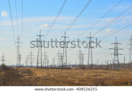 Power line in the countryside in the early spring on the outskirts of St. Petersburg, Russia. - stock photo