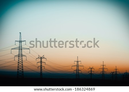 Power Line in the evening, cross-processing effect. - stock photo
