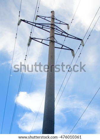 Power line on background of blue sky