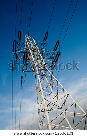 Power line pole on blue sky background - stock photo
