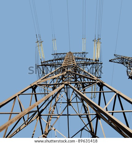 Power Line. pylon. Isolated on blue background - stock photo