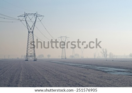 Power Line with morning fog - stock photo