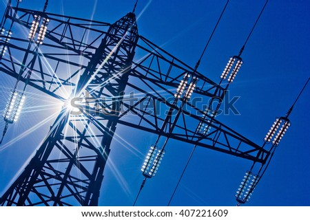 power line with sun - stock photo
