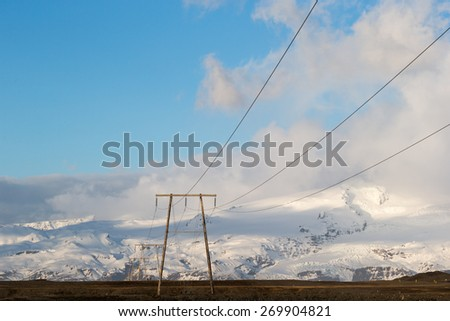 Power lines and electricity pylons and towers stretch across Iceland supplying ecologically friendly electricity sourced from geothermal energy from deep in the ground. - stock photo
