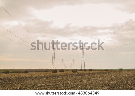 Power lines and hay bales