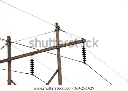 Power lines and pole on a white background
