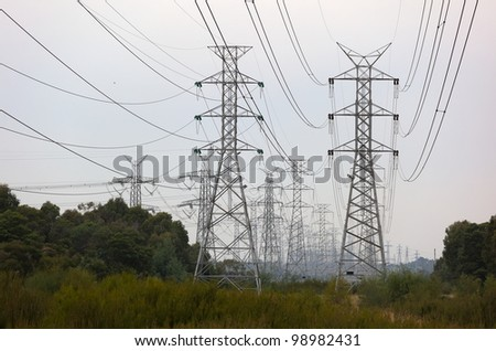 Power lines and towers on cloudy day. Melbourne. Australia. - stock photo