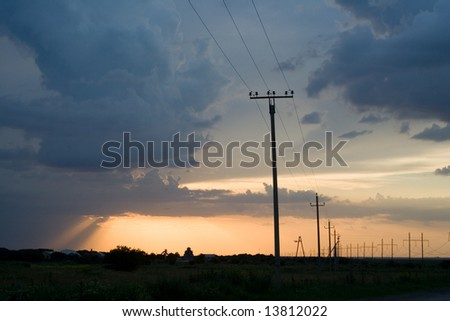 power lines at the beautiful background of the sky