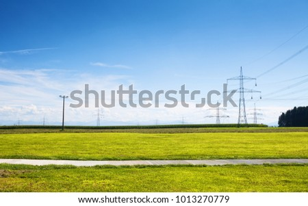 power lines in green field