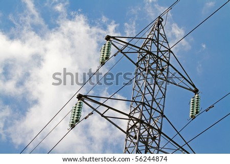 Power lines in the blue sky - stock photo