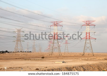 Power lines in the desert of Qatar, Middle East - stock photo