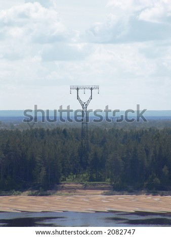 Power lines next to a river - stock photo