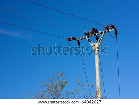 Power lines on blue sky - stock photo
