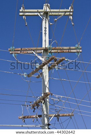 Power lines - pole with a multitude of lines in all directions - stock photo