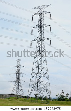 Power Lines, Pylon, Towers connected at power plant. - stock photo