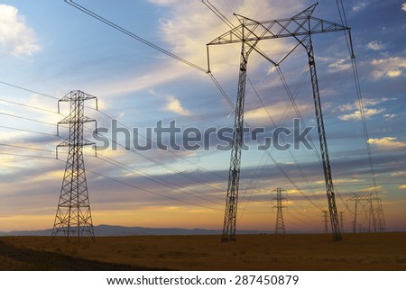 Power lines supported on pylons. - stock photo