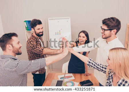 Power of friendship in business company.  Many hands clasped together - stock photo