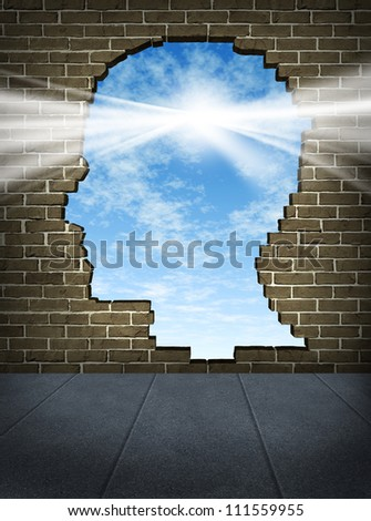 Power of the mind and free your brain mental health symbol of spirituality and freedom of thought with a human head shaped hole on a brick wall in a city street with a glowing sun on a blue sky. - stock photo