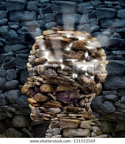 Power of thinking and free your mind as a business or health care concept with a group of rocks in the shape of a human head glowing with a bright inner light as a symbol of freedom and intelligence. - stock photo