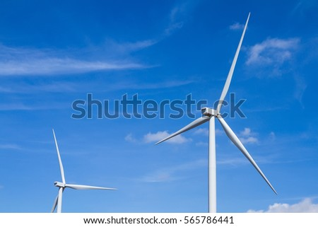Power of wind turbine generating electricity clean energy with cloud background on the blue sky.Global ecology.Clean energy concept save the world