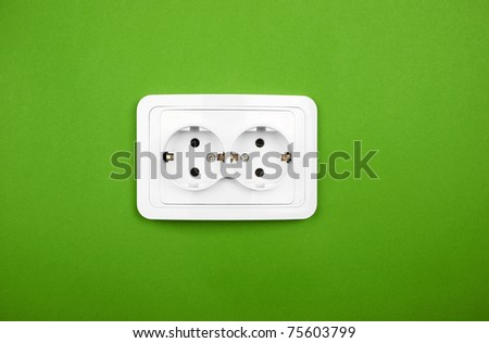 Power outlet on green wall - stock photo