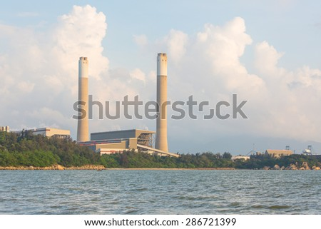 Power plant along coast - stock photo
