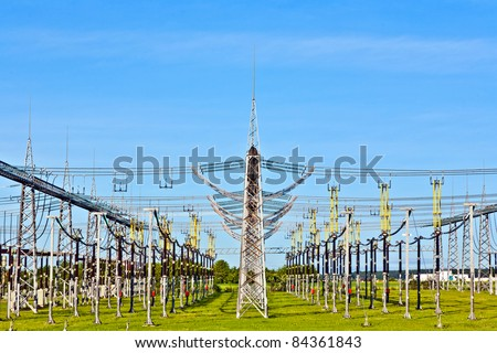 power plant and distribution station in beautiful landscape - stock photo